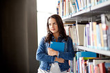 high school student girl with book at library