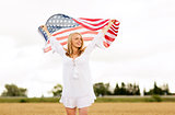happy woman with american flag on cereal field