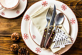 Christmas table setting on wooden background. Top view