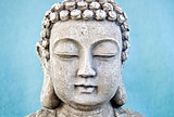Buddha face on blue background.