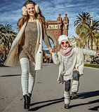 mother and daughter near Arc de Triomf in Barcelona walking
