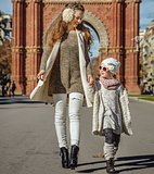 happy modern mother and child in Barcelona, Spain walking