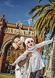 mother and daughter near Arc de Triomf having fun time