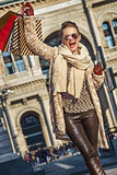 happy woman at Piazza del Duomo in Milan, Italy rejoicing