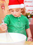 Little boy making Christmas cookies