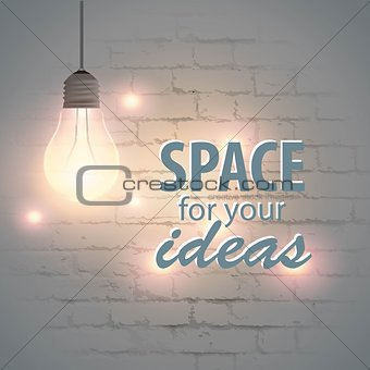 Glowing lamp on a brick wall background with space for your text