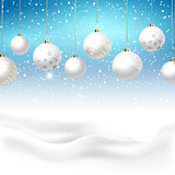 Christmas baubles on snowy background