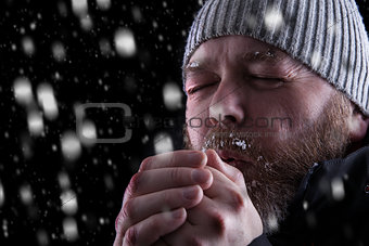 Freezing cold man in snow storm