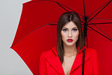 woman with red umbrella
