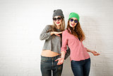 Two Smiling Fashion Hipster Girls in Spring