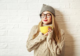 Winter Hipster Girl Enjoying a Cup of Hot Tea