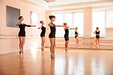Dancer is doing exercises in ballet class