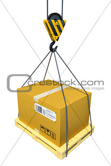 Pallet with cardboard lifted by crane