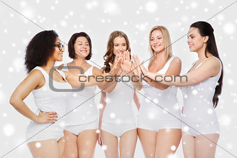 group of happy different women making high five