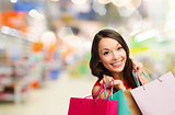 woman with shopping bags at store