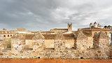 Cuenca vintage skyline with dark clouds