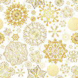 Winter seamless pattern with gold snowflakes