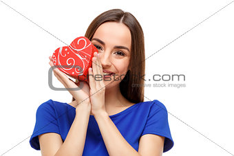 Beautiful woman holding heart shaped gift