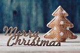text merry christmas and christmas tree
