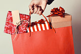 woman with a shopping bag full of gifts