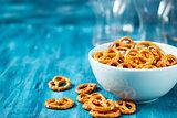 Salty snacks mini pretzels in bowl