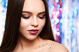 Woman make-up with shiny glitter and snow