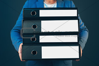 Business company accountant holding document binders