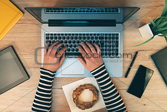 Office life, female hands working on laptop computer, top view
