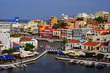 Agios Nikolaos, Crete, Greece. Agios Nikolaos is a picturesque town in the eastern part of the island Crete built on the northwest side of the peaceful bay of Mirabello.