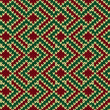 Seamless knitted pattern in red, green and beige colors