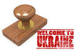 Red rubber stamp with welcome to Ukraine