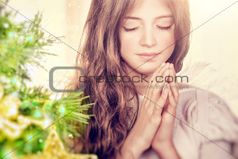 Beautiful angel praying