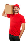 delivery man holding shipping box on the shoulder. isolated on w