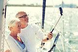 senior couple taking selfie on sail boat or yacht