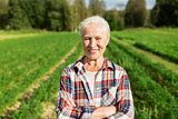 happy senior woman at farm