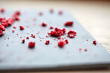 dried raspberries or berries on stone plate