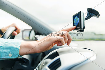 close up of man with gadget on screen driving car
