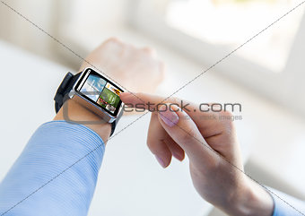 close up of female hands with news on smart watch