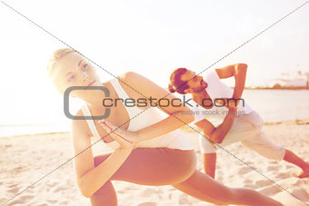close up of couple making yoga exercises outdoors