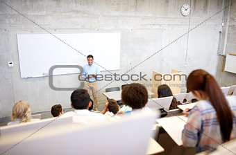 group of students and teacher at lecture