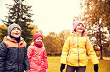 group of happy children in autumn park