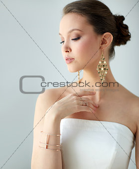 beautiful asian woman with earrings and bracelet