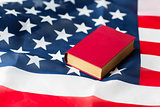 close up of american flag and book
