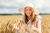 happy young woman in sun hat on cereal field