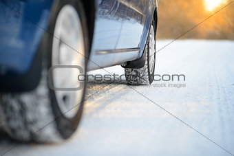 Close-up Image of Winter Car Tire on the Snowy Road. Drive Safe.