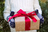 holding christmas gift