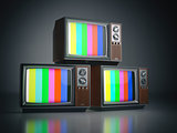 Heap of retro TV sets with no signal.