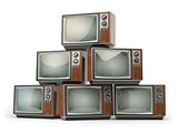 Heap of retro TV sets isolated on white background.
