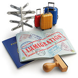 Immigration concept. Passport with stamps and visas, luggage and