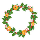 christmas watercolor wreath with oranges,candy canes,holly berries and leaves on white background.hand drawn illustration.